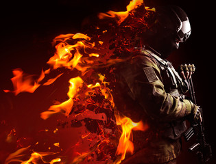 Profile view photo of a swat soldier with fire dissolving effect on black background.