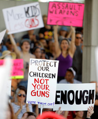 Protesters hold signs calling for more gun controls at a rally three days after the shooting at Marjory Stoneman Douglas High School, in Fort Lauderdale