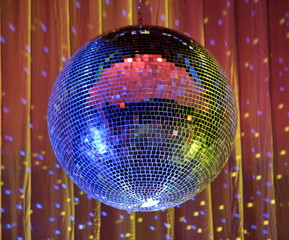night club lighting red-blue mirror-ball over curtains