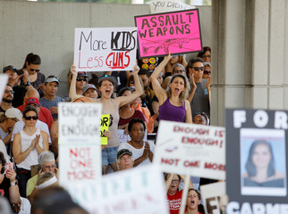 Protesters hold signs at a rally calling for more gun control three days after the shooting at Marjory Stoneman Douglas High School, in Fort Lauderdale