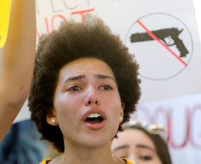 A protester weeps while chanting at a rally calling for more gun control three days after the shooting at Marjory Stoneman Douglas High School, in Fort Lauderdale