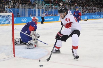 Olympics: Ice Hockey-Men Team Group A - KOR-SUI