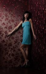 Woman in a beautiful dress posing in studio