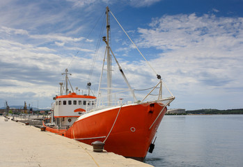 A docked orange ship