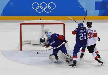 Olympics: Ice Hockey-Men Team Group A - KOR-SUI