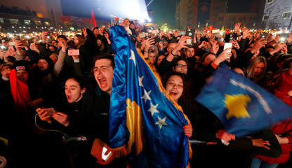 People cheer and take photos of Rita Ora's concert during celebration of the 10th anniversary of Kosovo's independence in Pristina