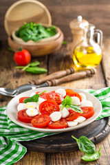 Tomato salad with mozzarella cheese and olive oil