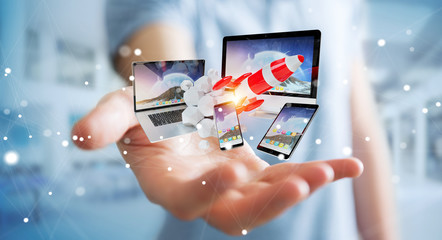 Businessman connecting tech devices and startup rocket 3D rendering