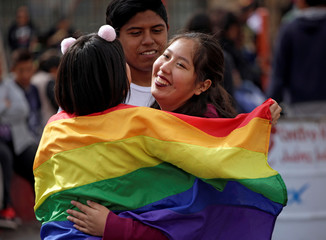 Members of the LGBT community hold a Hugathon to protest against homophobia and discrimination, in Ciudad Juarez