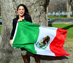 Laughing girl with Mexican Flag