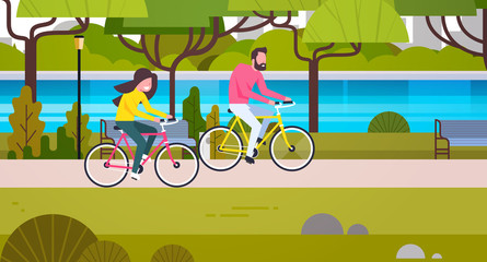 Couple Riding Bicycles In Public Park Man And Woman Cycling Outdoors Flat Vector Illustration