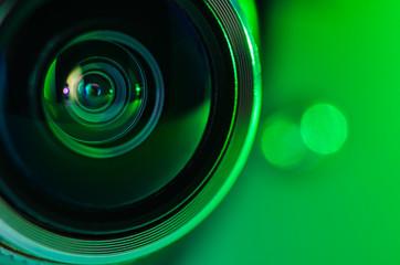 The camera lens and green backlighting . Horizontal photo