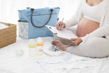 Prenatal pregnant women planning calendar and checklist appliance for baby, Preparing utensils for pregnancy concept