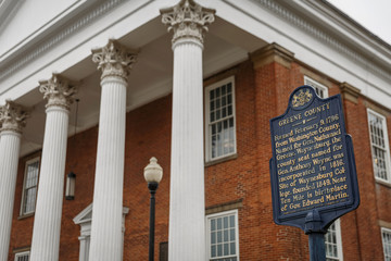 A sign stating the history of Greene County stands outside of the County Court House in Waynesburg