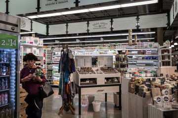 A woman shops in the Health & Beauty section of a Whole Foods in Upper St. Clair