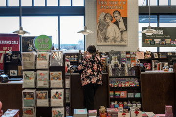 A woman pays for her purchase at a Barnes & Noble in Bethel Park