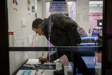 An attendee signs in to a campaign event held for Congressional candidate Conor Lamb in Carnegie
