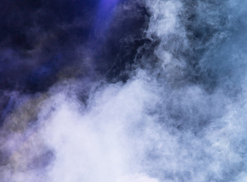 Multi-colored smoke at the concert at night