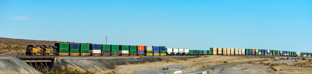 Long Cargo trains passing by in mirage, California USA
