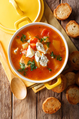 Delicious chicken buffalo soup with tomatoes, celery, carrots and blue cheese close-up in a saucepan. vertical top view