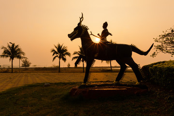 Sunrise and statue silhouette in the public park Ban Phe,Rayong,Thailand