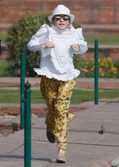 Canadian Prime Minister Justin Trudeau's daughter Ella Grace runs towards her father during their visit to the Taj Mahal in Agra