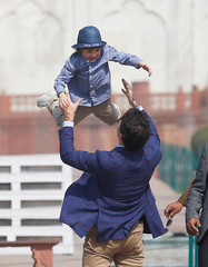 Canadian Prime Minister Justin Trudeau plays with his son Hadrien during their visit to the Taj Mahal in Agra