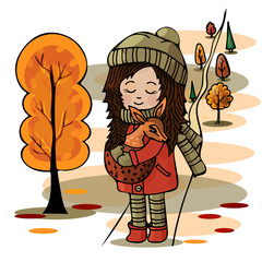 Cute girl with a deer in her hands in the autumn forest. Love, friendship with animals.