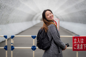 Beautiful woman posing in front of a white tunnel