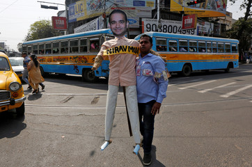 A demonstrator holds an effigy depicting billionaire jeweller Nirav Modi during a protest in Kolkata