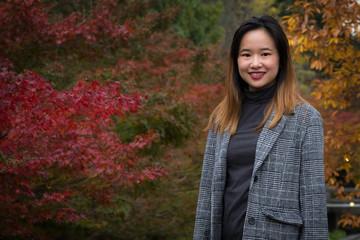 Beautiful woman posing in a Japanese garden