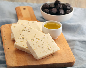 Sliced feta cheese, olives, and olive oil