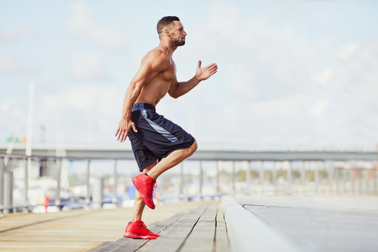 Man doing interval exercises on stairs during hiit workout