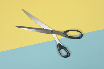 Flat lay of scissors on two tone background, Sewing and needlework concept.