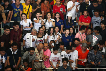 People react as they watch a cockfighting match with the highest cash reward of cockfighting in Thai history for more than one million USD in a stadium on the outskirts of Bangkok