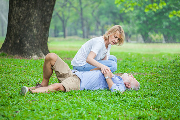 Elderly man have chest pains or heart attack in the park, health care concept.