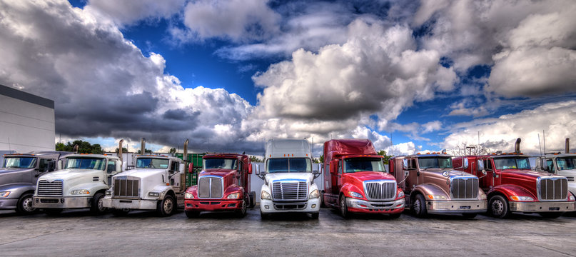 HDR image of Semi trucks lined up on a parking lot