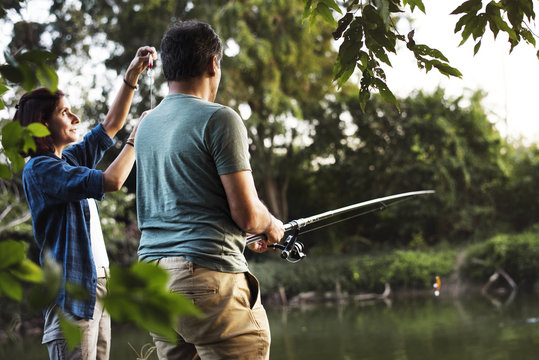 Couple fishing in the jungle