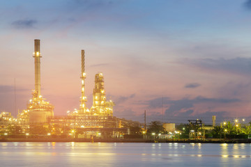 Night view Oil refinery river front beauty twilight sky background