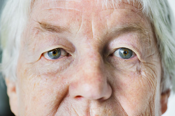 Portrait of white elderly woman closeup on eyes