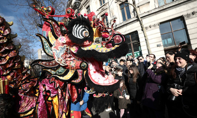 Performers dressed in traditional lion and dragon costumes take part in the Chinese New Year parade through central London