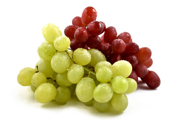 Red and white grapes stock images. Grapes on a white background. Dewy fresh grapes
