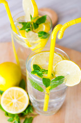 Glasss of mojito with lemon and drinking straw