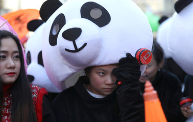 People take part in the Chinese New Year parade through central London