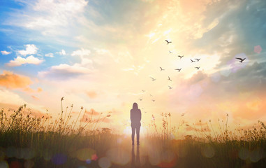 World environment day concept: Silhouette alone woman standing on abstract of heaven background
