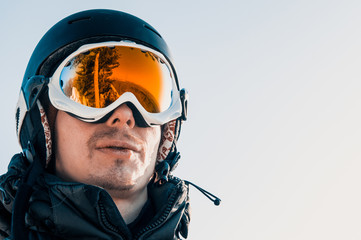 yellow ski goggles and snowboarder in the mountains
