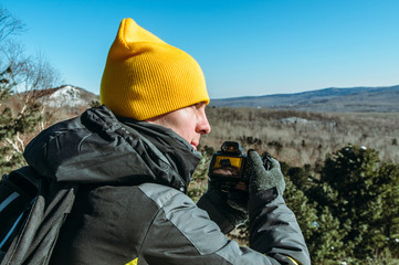 photographer naturalist at work in winter on top of the mountain