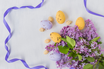 Easter eggs and lilac branches