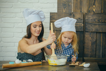 Mother and son mixing flour and eggs in bowl