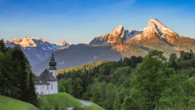 Panoramic view of Maria Gern church with snow-capped summit of Watzmann mountain